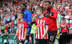 SOUTHAMPTON, ENGLAND - AUGUST 25: Ryan Bertrand of Southampton leads the teams out with the matchday mascots during the Premier League match between Southampton FC and Leicester City at St Mary's Stadium on August 25, 2018 in Southampton, United Kingdom. (Photo by Matt Watson/Southampton FC via Getty Images)