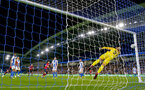 BRIGHTON, ENGLAND - AUGUST 28: Charlie Austin of Southampton beats Brighton goalkeeper David Button with a header during the Carabao Cup Second Round match between Brighton & Hove Albion and Southampton at American Express Community Stadium on August 28, 2018 in Brighton, England. (Photo by Matt Watson/Southampton FC via Getty Images)