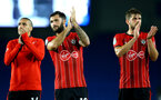 BRIGHTON, ENGLAND - AUGUST 28: LtoR Oriol Romeu, Charlie Austin, Jack Stephens after the final whistle is blown for the Carabao Cup Second Round match between Brighton & Hove Albion and Southampton at American Express Community Stadium on August 28, 2018 in Brighton, England. (Photo by James Bridle - Southampton FC/Southampton FC via Getty Images)