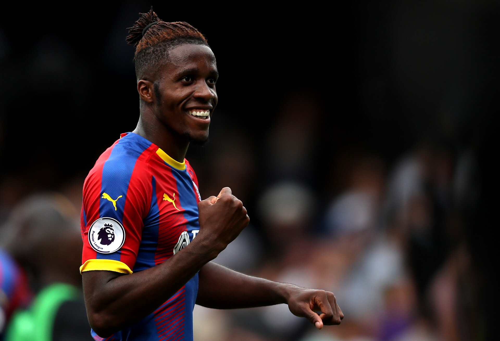 LONDON, ENGLAND - AUGUST 11:  Wilfried Zaha of Crystal Palace celebrates following his sides victory in the Premier League match between Fulham FC and Crystal Palace at Craven Cottage on August 11, 2018 in London, United Kingdom.  (Photo by Christopher Lee/Getty Images)