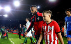 SOUTHAMPTON, ENGLAND - SEPTEMBER 17: Ryan Bertrand (left) walk out with Mascot ahead of kick off for the Premier League match between Southampton FC and Brighton & Hove Albion at St Mary's Stadium on September 17, 2018 in Southampton, United Kingdom. (Photo by James Bridle - Southampton FC/Southampton FC via Getty Images)