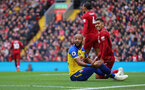 LIVERPOOL, ENGLAND - SEPTEMBER 22: Nathan Redmond(L) of Southampton looks to the linesman as Robrto Firmino(R) of Liverpool looks on during the Premier League match between Liverpool FC and Southampton FC at Anfield on September 22, 2018 in Liverpool, United Kingdom. (Photo by Matt Watson/Southampton FC via Getty Images)