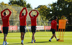 SOUTHAMPTON, ENGLAND - OCTOBER 01: Maya Yoshida (right) wamrs up during a Southampton FC training session at Staplewood Complex on October 1, 2018 in Southampton, England. (Photo by James Bridle - Southampton FC/Southampton FC via Getty Images)