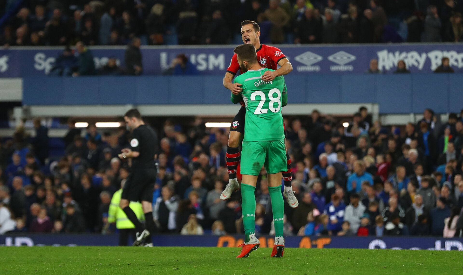 LIVERPOOL, ENGLAND - OCTOBER 02: Cedric and Angus Gunn of Southampton celebrate during the Carabao Cup Third Round match between Everton and Southampton at Goodison Park on October 2nd, 2018 in Liverpool, England. (Photo by Matt Watson/Southampton FC via Getty Images)