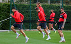SOUTHAMPTON, ENGLAND - OCTOBER 05: Mohamed Elyounoussi(L) and team mates warm up during a Southampton FC training session at the Staplewood Campus on October 5, 2018 in Southampton, England. (Photo by Matt Watson/Southampton FC via Getty Images)