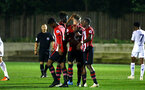 SOUTHAMPTON, ENGLAND - OCTOBER 05: Callum slattery scores from the penalty spot (middle) and celebrated with his team mates during the PL2 match between Southampton FC and Leeds United FC U23s pictured at Staplewood Complex on October 5, 2018 in Southampton, England. (Photo by James Bridle - Southampton FC/Southampton FC via Getty Images)