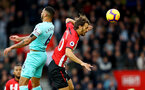 SOUTHAMPTON, ENGLAND - OCTOBER 27: Manolo Gabbiadini(R) of Southampton jumps with Jamaal Lascelles of Newcastle during the Premier League match between Southampton FC and Newcastle United at St Mary's Stadium on October 27, 2018 in Southampton, United Kingdom. (Photo by Matt Watson/Southampton FC via Getty Images)