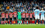 MANCHESTER, ENGLAND - NOVEMBER 04: Southampton players participate in a minute's silence in honour of the Leicester Chairman, during the Premier League match between Manchester City and Southampton FC at Etihad Stadium on November 4, 2018 in Manchester, United Kingdom. (Photo by Matt Watson/Southampton FC via Getty Images)