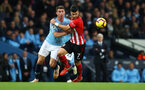 MANCHESTER, ENGLAND - NOVEMBER 04: Shane Long(R) of Southampton battles with Americ Laporte during the Premier League match between Manchester City and Southampton FC at Etihad Stadium on November 4, 2018 in Manchester, United Kingdom. (Photo by Matt Watson/Southampton FC via Getty Images)