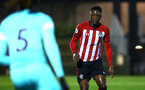 SOUTHAMPTON, ENGLAND - NOVEMBER 09: Jonathan Afolabi (right) during the Premier League 2 match between Southampton FC and Newcastle United pictured at Staplewood Complex on November 09, 2018 in Southampton, England. (Photo by James Bridle - Southampton FC/Southampton FC via Getty Images)