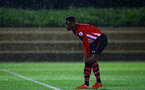SOUTHAMPTON, ENGLAND - NOVEMBER 09: Jonathan Afolabi adjusts his shin pads during the Premier League 2 match between Southampton FC and Newcastle United pictured at Staplewood Complex on November 09, 2018 in Southampton, England. (Photo by James Bridle - Southampton FC/Southampton FC via Getty Images)