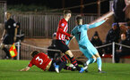 SOUTHAMPTON, ENGLAND - DECEMBER 14: Jake Vokins slides to take the ball (left) during the U23s PL2 match between Southampton FC and Newcastle United pictured at Staplewood Training Ground on December 14, 2018 in Southampton England. (Photo by James Bridle - Southampton FC/Southampton FC via Getty Images)