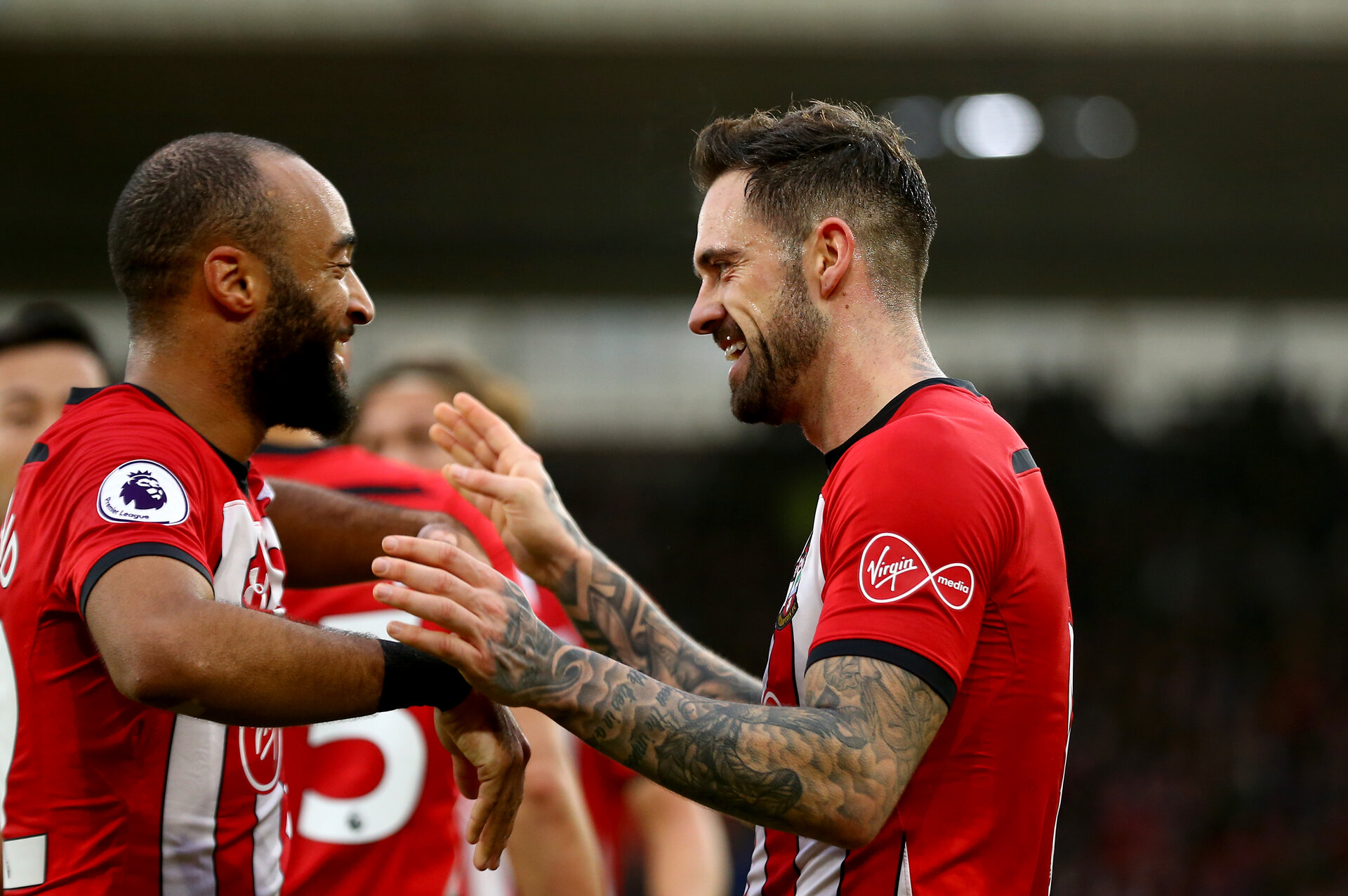 SOUTHAMPTON, ENGLAND - DECEMBER 16: Danny Ings(R) of Southampton celebrates with Nathan Redmond after scoring his second during the Premier League match between Southampton FC and Arsenal FC at St Mary's Stadium on December 15, 2018 in Southampton, United Kingdom. (Photo by Matt Watson/Southampton FC via Getty Images)