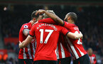 SOUTHAMPTON, ENGLAND - DECEMBER 16: LtoR Stuart Armstrong, Nathan Redmond, celebrates with Danny Ings after he scores and celebrates during the Premier League match between Southampton FC and Arsenal FC at St Mary's Stadium on December 16, 2018 in Southampton, United Kingdom. (Photo by James Bridle - Southampton FC/Southampton FC via Getty Images)