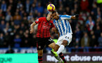 HUDDERSFIELD, ENGLAND - DECEMBER 22:  Oriol Romeu(L) of Southampton and Steve Mounie(R) of Huddersfield Town during the Premier League match between Huddersfield Town and Southampton FC at John Smith's Stadium on December 22, 2018 in Huddersfield, United Kingdom. (Photo by Matt Watson/Southampton FC via Getty Images)