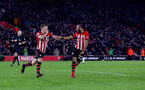 SOUTHAMPTON, ENGLAND - JANUARY 19: James Ward-Prowse of Southampton(L) celebrates with Nathan Redmond both of Southampton after opening the scoring during the Premier League match between Southampton FC and Everton FC at St Mary's Stadium on January 19, 2019 in Southampton, United Kingdom. (Photo by Matt Watson/Southampton FC via Getty Images)