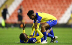 LEIGH, GREATER MANCHESTER - FEBRUARY 01:  Nathan Tella of Southampton FC (right) runs to Jonathan Afolabi as he lays on the floor after the final whistle is blown for the PL2 match between Manchester United and Southampton FC pictured at Leigh Sports Village on February 01, 2019 in Leigh, Greater Manchester. (Photo by James Bridle - Southampton FC/Southampton FC via Getty Images)