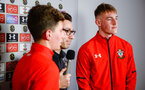SOUTHAMPTON, ENGLAND - FEBRUARY 14: Tom Deacon speaks with U18s players from Southampton FC James Morris (left) Jack Bycroft (right) during the ePremier League tournament held at St Mary's Stadium on February 14, 2019 in Southampton, England. (Photo by James Bridle - Southampton FC/Southampton FC via Getty Images)