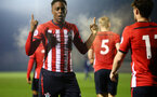 SOUTHAMPTON, ENGLAND - FEBRUARY 15: Jonathan Afolabi   scores for Southampton FC and celebrates (left) during the U23s PL2 match between Southampton FC and Fulham FC pictured at Staplewood Complex on February 15, 2019 in Southampton, England. (Photo by James Bridle - Southampton FC/Southampton FC via Getty Images)