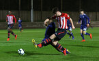 SOUTHAMPTON, ENGLAND - FEBRUARY 15: Will Ferry of Southampton FC (right) shoots during the U23s PL2 match between Southampton FC and Fulham FC pictured at Staplewood Complex on February 15, 2019 in Southampton, England. (Photo by James Bridle - Southampton FC/Southampton FC via Getty Images)
