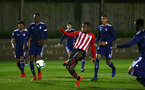 SOUTHAMPTON, ENGLAND - FEBRUARY 15: Jonathan Afolabi (middle) shoots for Southampton FC however the ball finds the far post during the U23s PL2 match between Southampton FC and Fulham FC pictured at Staplewood Complex on February 15, 2019 in Southampton, England. (Photo by James Bridle - Southampton FC/Southampton FC via Getty Images)