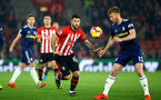 SOUTHAMPTON, ENGLAND - FEBRUARY 27:  LtoR Charlie Austin takes on Tim Ream of Fulham during the Premier League match between Southampton FC and Fulham FC at St Mary's Stadium on February 27, 2019 in Southampton, United Kingdom. (Photo by James Bridle - Southampton FC/Southampton FC via Getty Images)
