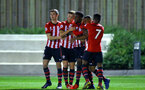 SOUTHAMPTON, ENGLAND - MARCH 01: Tyreke Johnson scores (middle) and celebrates with Tom O'Connor, Harry Hamblin, Jonathan Afolabi , Nathan Tella during the PL2 match between Southampton FC and Reading FC pictured at Staplewood Complex on March 01, 2019 in Southampton, England. (Photo by James Bridle - Southampton FC/Southampton FC via Getty Images)