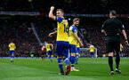 MANCHESTER, ENGLAND - MARCH 02: James Ward-Prowse of Southampton celebrates with team mates during the Premier League match between Manchester United and Southampton FC at Old Trafford on March 02, 2019 in Manchester, United Kingdom. (Photo by Matt Watson/Southampton FC via Getty Images)