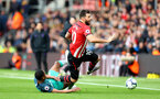 SOUTHAMPTON, ENGLAND - MARCH 09: Charlie Austin(R) of Southampton is fouled by Kyle Walker-Peters of Tottenham Hotspur  during the Premier League match between Southampton FC and Tottenham Hotspur at St Mary's Stadium on March 09, 2019 in Southampton, United Kingdom. (Photo by Matt Watson/Southampton FC via Getty Images)