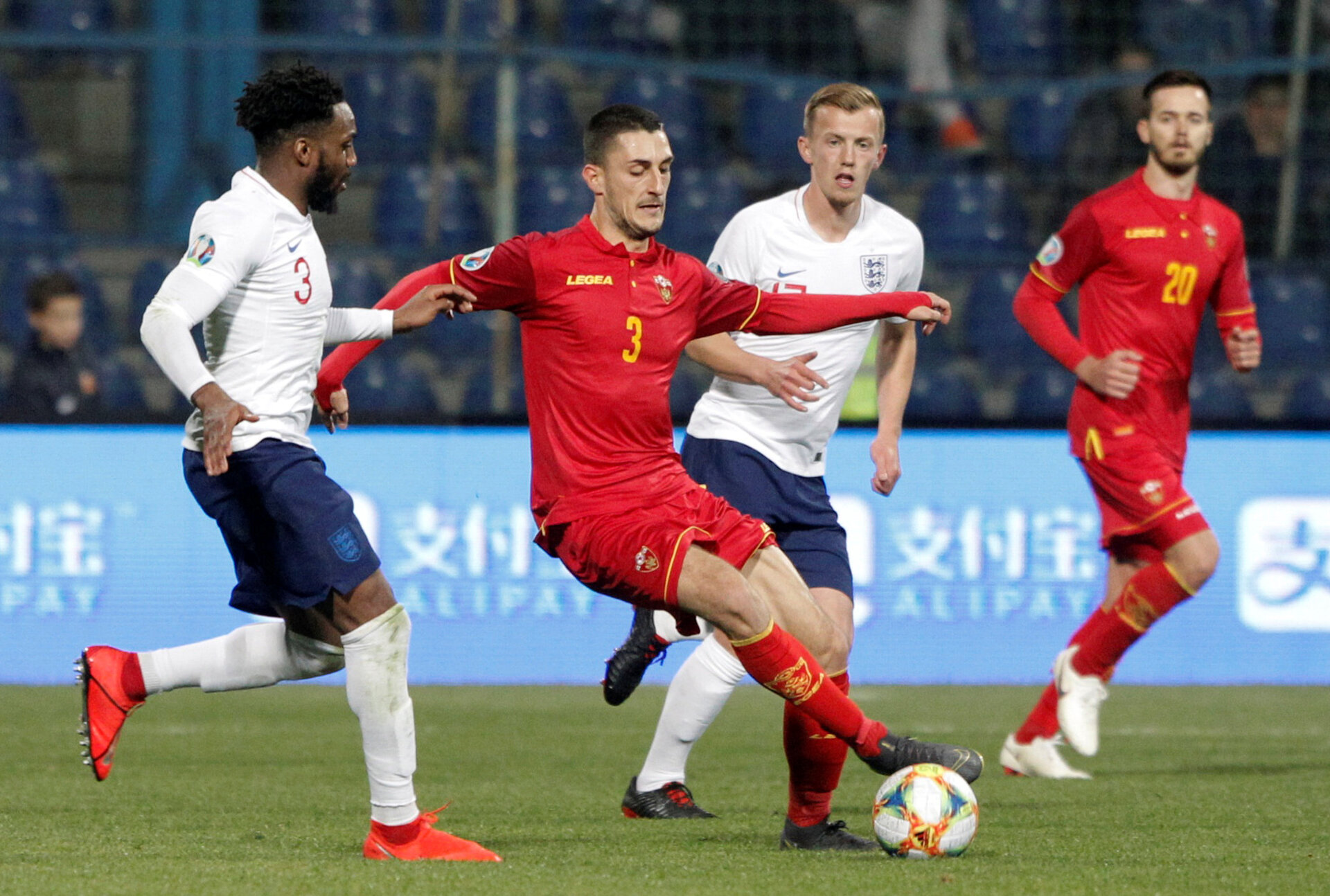 Soccer Football - Euro 2020 Qualifier - Group A - Montenegro v England - Podgorica City Stadium, Podgorica, Montenegro - March 25, 2019  England's James Ward-Prowse and Danny Rose in action with Montenegro's Aleksandar Boljevic              REUTERS/Stevo Vasiljevic