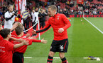 SOUTHAMPTON, ENGLAND - APRIL 13: James Ward-Prowse meets Saints Foundation mascots during the Premier League match between Southampton FC and Wolverhampton Wanderers at St Mary's Stadium on April 13, 2019 in Southampton, United Kingdom. (Photo by Matt Watson/Southampton FC via Getty Images)