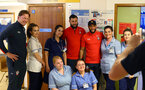 SOUTHAMPTON, ENGLAND - APRIL 17: LtoR Ralph Hasenhuttl, Charlie Austin, Maya Yoshida of Southampton FC visits Southampton General Hospital pictured with patients and staff on April 17, 2019 in Southampton, England. (Photo by James Bridle - Southampton FC/Southampton FC via Getty Images)