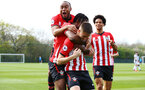WEST BROMWICH, ENGLAND - APRIL 18: Will Smallbone of Southampton scores and celebrates (Front-centre) along side team mates Tyreke Johnson (centre-back) Dan Nlundulu (centre-middle) and Oludare Olufunwa (right) during the Under 23s PL2 match between West Bromwich and Southampton FC pictured on April 18, 2019 in West Bromwich, England. (Photo by James Bridle - Southampton FC/Southampton FC via Getty Images)