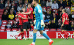 WATFORD, ENGLAND - APRIL 23: Shane Long(7) of Southampton celebrates with his team mates after opening the scoring during the Premier League match between Watford FC and Southampton FC at Vicarage Road on April 23, 2019 in Watford, United Kingdom. (Photo by Matt Watson/Southampton FC via Getty Images)