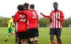NORWICH, ENGLAND - APRIL 27: Christian Norton in scores and celebrates (middle) with Rio Glean (back-centre) Rowland Idowu  (right) during a U18 Premier League match between Norwich City FC and Southampton FC pictured at Colney Training Ground on April 27, 2019 in Norwich, England. (Photo by James Bridle - Southampton FC/Southampton FC via Getty Images)