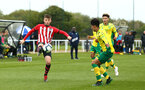 NORWICH, ENGLAND - APRIL 27: Ryan Cluett  (left) during a U18 Premier League match between Norwich City FC and Southampton FC pictured at Colney Training Ground on April 27, 2019 in Norwich, England. (Photo by James Bridle - Southampton FC/Southampton FC via Getty Images)
