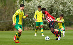 NORWICH, ENGLAND - APRIL 27: Alexandre Jankewitz (middle) tugged down during a U18 Premier League match between Norwich City FC and Southampton FC pictured at Colney Training Ground on April 27, 2019 in Norwich, England. (Photo by James Bridle - Southampton FC/Southampton FC via Getty Images)