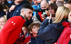 SOUTHAMPTON, ENGLAND - MAY 08: Shane Long (left) has a photo with a fan during a Southampton FC open training session at St Mary's Stadium on May 08, 2019 in Southampton, England. (Photo by James Bridle - Southampton FC/Southampton FC via Getty Images)