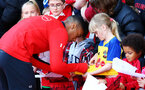 SOUTHAMPTON, ENGLAND - MAY 08: Yan Valery (left)  signs a young fans shirt during a Southampton FC open training session at St Mary's Stadium on May 08, 2019 in Southampton, England. (Photo by James Bridle - Southampton FC/Southampton FC via Getty Images)