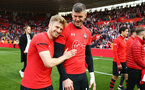 SOUTHAMPTON, ENGLAND - MAY 12: LtoR Stuart Armstrong, Fraser Forster during the lap of honor for the Premier League match between Southampton FC and Huddersfield Town at St Mary's Stadium on May 12, 2019 in Southampton, United Kingdom. (Photo by James Bridle - Southampton FC/Southampton FC via Getty Images)