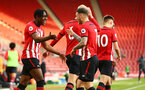 SOUTHAMPTON, ENGLAND - MAY 13: LtoR Dan Nlundulu, Callum Slattery celebrate after Dan Nlundulu  scores from a header during the U23s PL2 Play off final between Southampton and Newcastle United pictured at St. Mary's Stadium on May 13, 2019 in Southampton, England. (Photo by James Bridle - Southampton FC/Southampton FC via Getty Images)