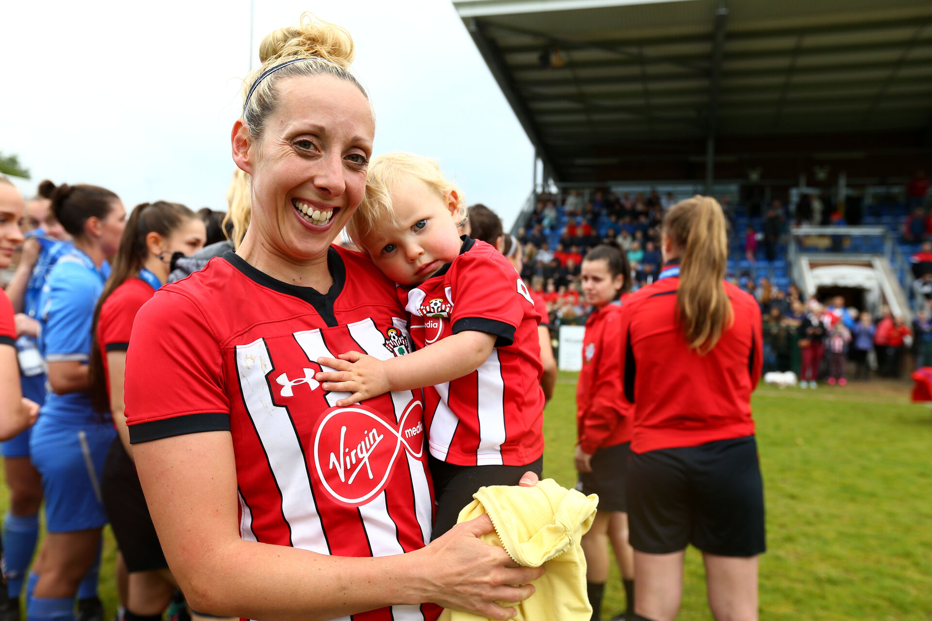 SOUTHAMPTON, ENGLAND - MAY 19: Shelly Proven with her young child after winning the Womens Cup Final match between Southampton FC and Oxford pictured at AFC Totten on May 19, 2019 in Southampton, England. (Photo by James Bridle - Southampton FC/Southampton FC via Getty Images)