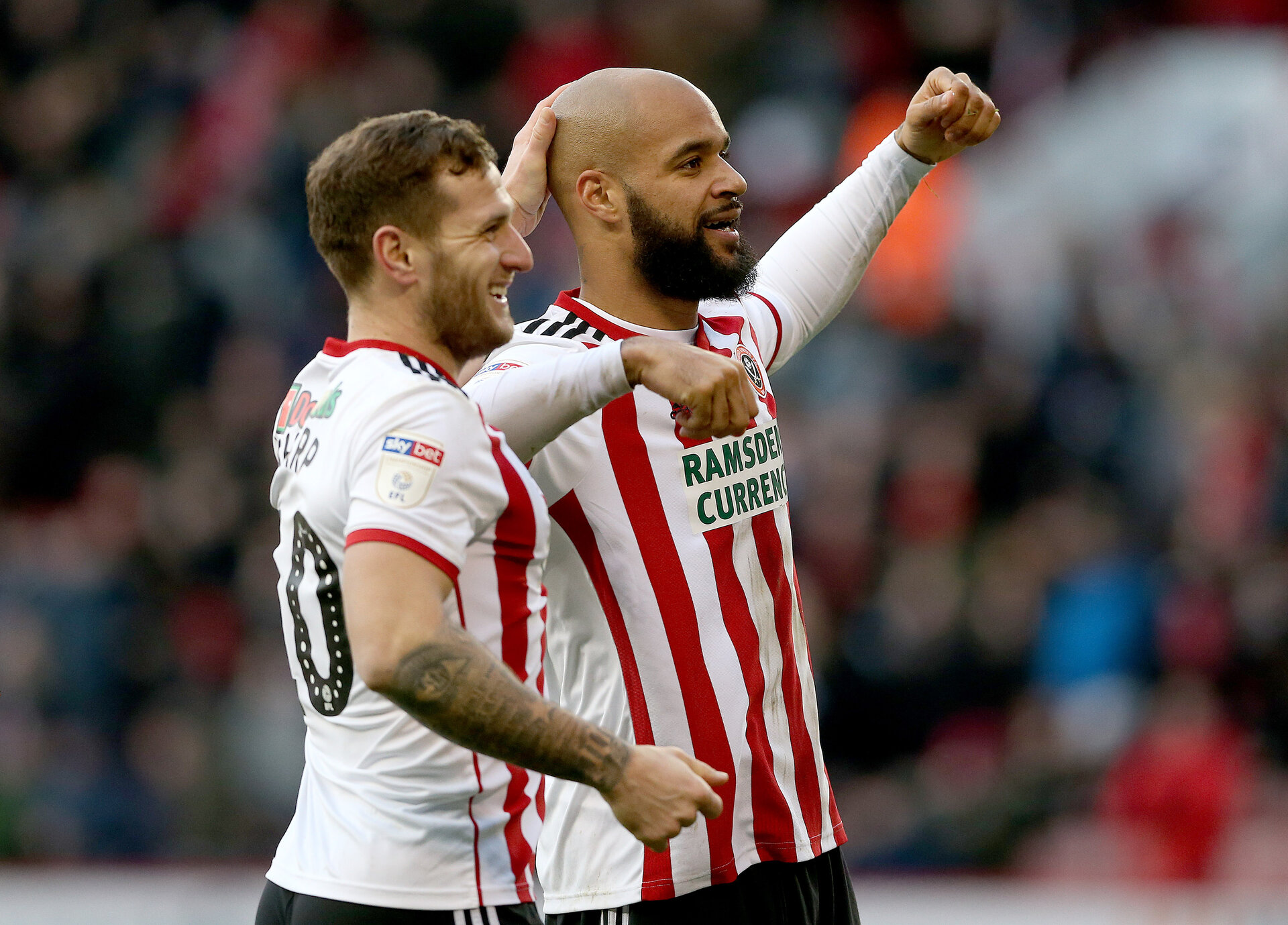 SHEFFIELD, ENGLAND - FEBRUARY 02:  David McGoldrick (R) of Sheffield United celebrates scoring with Billy Sharp during the Sky Bet Championship match between Sheffield United and Bolton Wanderers at Bramall Lane on February 2, 2019 in Sheffield, England. (Photo by Nigel Roddis/Getty Images)