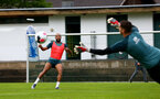SCHRUNS, AUSTRIA - JULY 12: Nathan Redmond(L) sees his shot saved by Alex McCarthy during a Southampton FC pre season training session on July 12, 2019 in Schruns, Austria. (Photo by Matt Watson/Southampton FC via Getty Images)