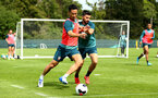 DUBLIN, ENGLAND - JULY 27: LtoR Maya Yoshida takes on Shane Long during a Southampton FC Training session pictured at Carton House Spa and Resort for Pre-Season Training on July 27, 2019 in Southampton, England. (Photo by James Bridle - Southampton FC/Southampton FC via Getty Images)