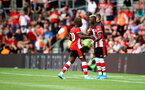 SOUTHAMPTON, ENGLAND - AUGUST 03: Moussa Djenepo(R) comes on for Michael Obafemi to make his Southampton FC debut during the Pre-Season Friendly match between Southampton FC and FC Köln at St. Mary's Stadium on August 03, 2019 in Southampton, England. (Photo by Matt Watson/Southampton FC via Getty Images,)