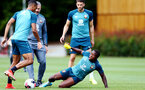 SOUTHAMPTON, ENGLAND - AUGUST 15: Michael Obafemi (right) slides to take Yan Valery (left) during a Southampton FC Training session pictured on August 15, 2019 in Southampton, England. (Photo by James Bridle - Southampton FC/Southampton FC via Getty Images)