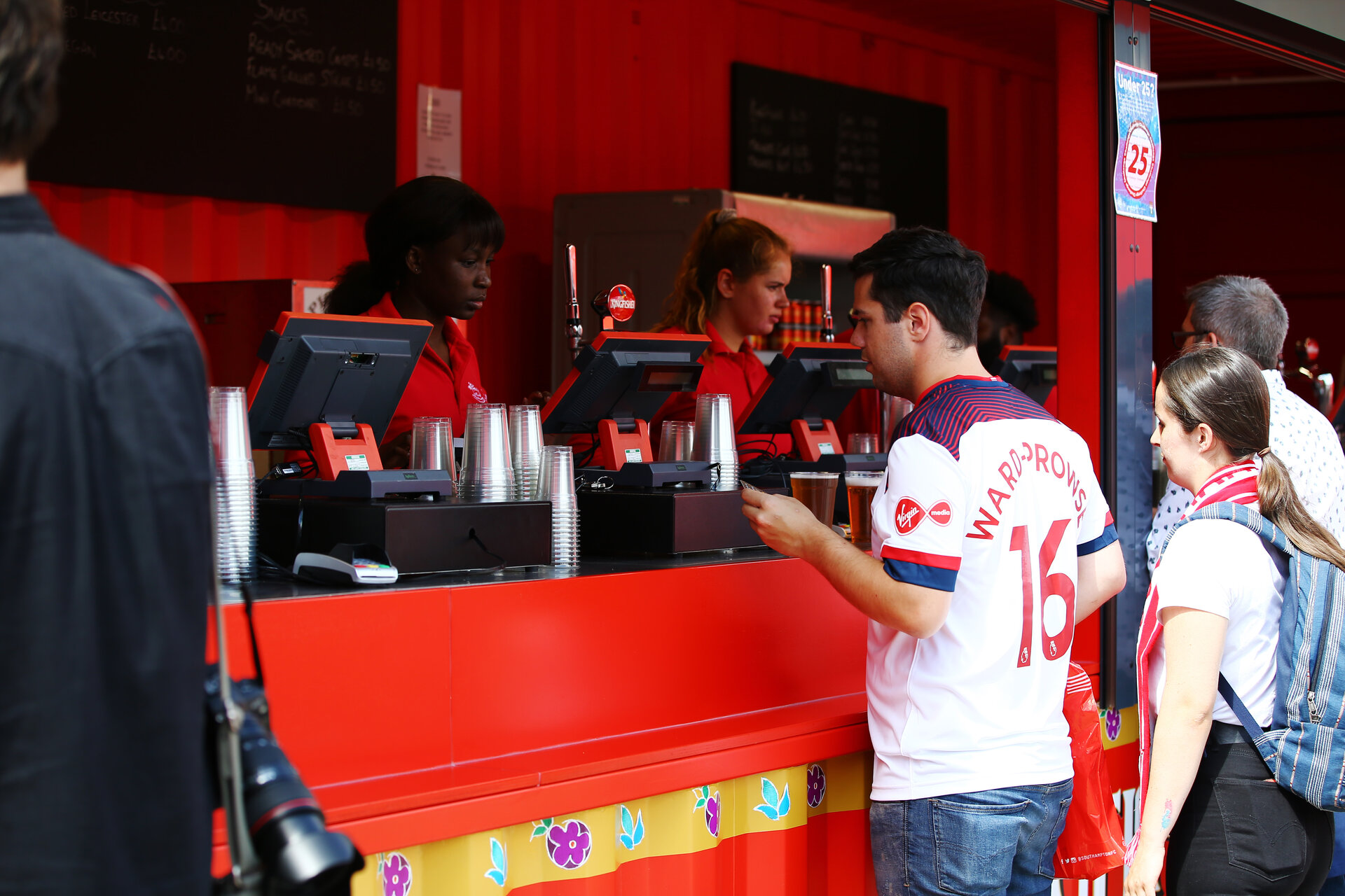 SOUTHAMPTON, ENGLAND - AUGUST 17: Bar staff inside the fan zone ahead of the Premier League match between Southampton FC and Liverpool FC at St Mary's Stadium on August 17, 2019 in Southampton, United Kingdom. (Photo by James Bridle - Southampton FC/Southampton FC via Getty Images)