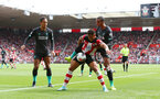 SOUTHAMPTON, ENGLAND - AUGUST 17: Ché Adams(centre) of Southampton under pressure from Joel Matip(R) and Virgil Van Dijk(L) of Liverpool during the Premier League match between Southampton FC and Liverpool FC at St Mary's Stadium on August 17, 2019 in Southampton, United Kingdom. (Photo by Matt Watson/Southampton FC via Getty Images)