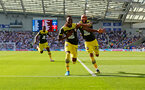 BRIGHTON, ENGLAND - AUGUST 24: Moussa Djenepo(L) of Southampton celebrates with Nathan Redmond(R) during the Premier League match between Brighton & Hove Albion and Southampton FC at American Express Community Stadium on August 24, 2019 in Brighton, United Kingdom. (Photo by Matt Watson/Southampton FC via Getty Images)
